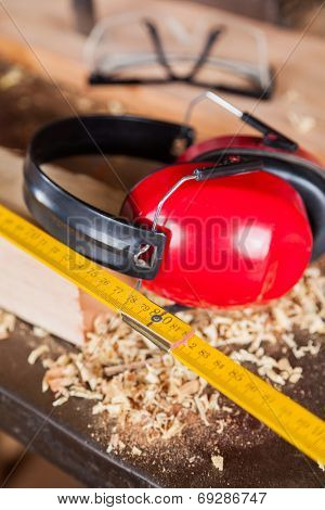 Closeup of ruler and ear protectors in workshop