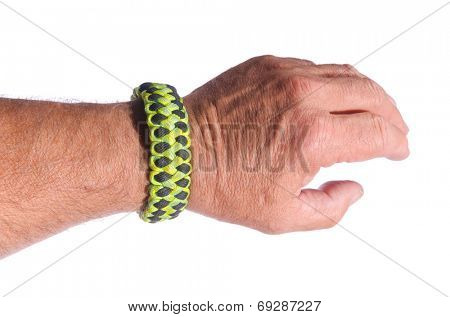 Mans arm with a double piranha weave survival bracelet in camouflage paracord, isolated over white