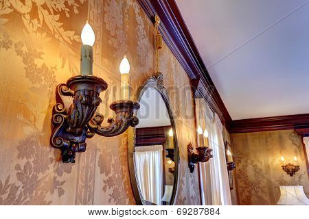 Wall With Antique Candelabrums And Mirror