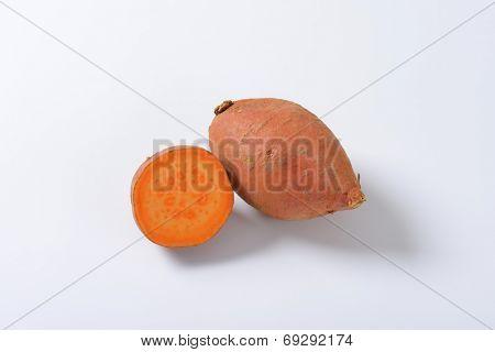 one and half batata sweet potatoe on white background