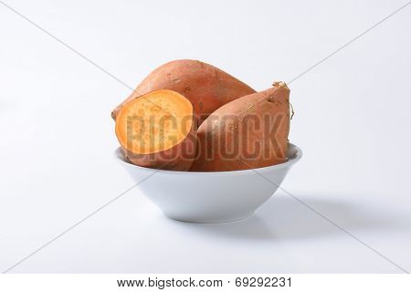 bowl of batata sweet potatoes on white background