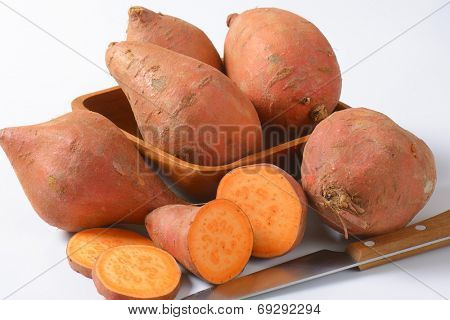 close up of batata sweet potatoes and kitchen knife