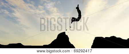 Concept or conceptual young man or businessman silhouette jump happy from cliff over  gap sunset or sunrise sky banner background