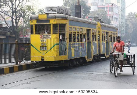 KOLKATA, INDIA - FEB 15: Traditional tram downtown Kolkata on February 15, 2014. Kolkata is the only Indian city with a tram network, which is operated by the Calcutta Tramways Comp.