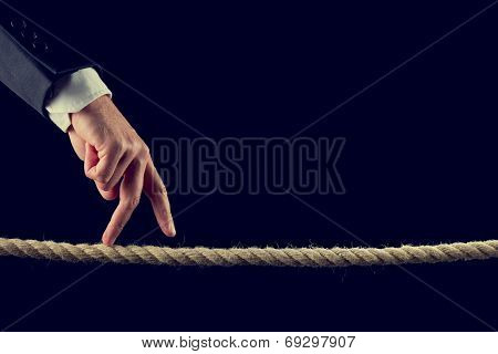 Fingers Walking Over Frayed Rope
