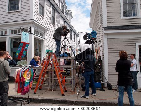 Large Crew Films Scene In Historic Area