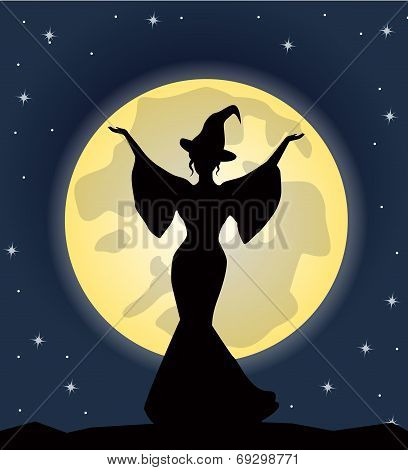 beautiful witch standing on background of the moon