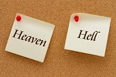 stock photo of hell  - Heaven versus Hell Two yellow sticky notes on a cork board with the words Heaven and Hell - JPG