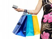 stock photo of overspending  - closeup of picture of woman with shopping bags and credit card - JPG