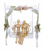 stock photo of swingset  - Dating couple sitting on a white Garden Swing with their arms around each other  - JPG