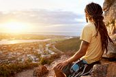 foto of dreadlocks  - A man in dreadlocks on a mountain looking at the view with copyspace - JPG