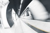 stock photo of underpass  - Modern interior of a subway station blurred train - JPG