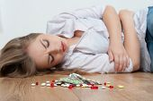 stock photo of wife-beater  - Big heap of different pills lying on the floor - JPG
