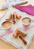 image of eclairs  - Hot coffee and a variety of little french eclairs - JPG