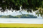 foto of chan  - Landscaped lawns for relaxing waterfront under the tree at Kaeng Kra Chan National Park in Phetchaburi Province Thailand - JPG