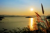 stock photo of chan  - High angle view beautiful lake at sunset on the Kaeng Kra Chan Dam view point in National Park Phetchaburi Province Thailand - JPG