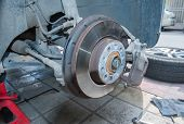 stock photo of motor coach  - Car disc break detail with a little rust and dirt - JPG