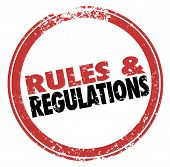 stock photo of policy  - Rules and Regulations words in a red stamp illustrating laws - JPG
