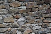 image of oxidation  - Wall of stones with iron oxide content iron oxide red ocher - JPG