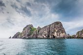 image of chums  - Tropical rock island against blue sky and sea Chum porn Thailand - JPG