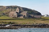stock photo of bute  - Iona Abbey is located on the Isle of Iona just off the Isle of Mull on the West Coast of Scotland - JPG