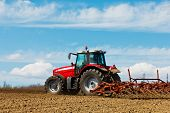 image of plowed field  - Farmer plowing the field - JPG