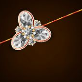 stock photo of rakhi  - Beautiful shiny Rakhi on brown background for the occasion of Raksha Bandhan festival - JPG