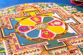 stock photo of tantra  - Tibetian monks constructing mandala from colored sand - JPG