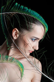 pic of female peacock  - Beautiful brunette young woman with peacock style make - JPG