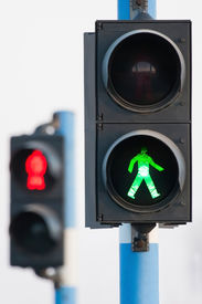 image of traffic signal  - Traffic lights for pedestrians on two semaphores in traffic - JPG