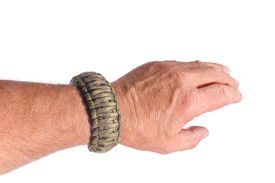 pic of paracord  - Mans arm with a double cobra weave survival bracelet in camouflage paracord - JPG