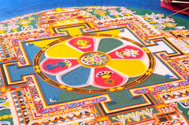foto of tantra  - Tibetian monks constructing mandala from colored sand - JPG