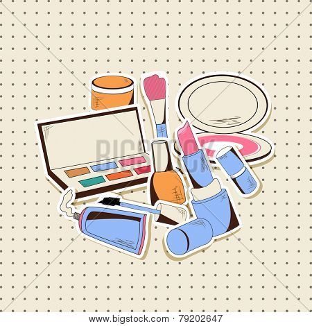 Make-up cosmetic products with brush on dotted beige background.