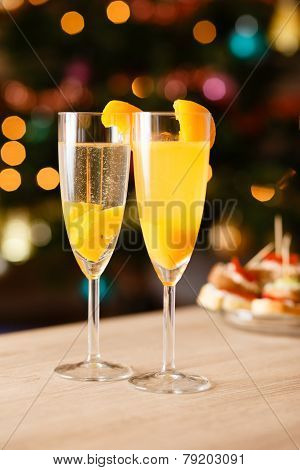 Two glasses of sparkling wine with apricot