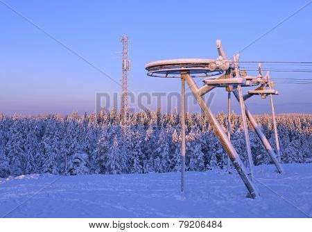 End of a ski lift in winter snow.