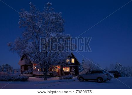 Winter landscape in the night. Farm buildings after sunset.