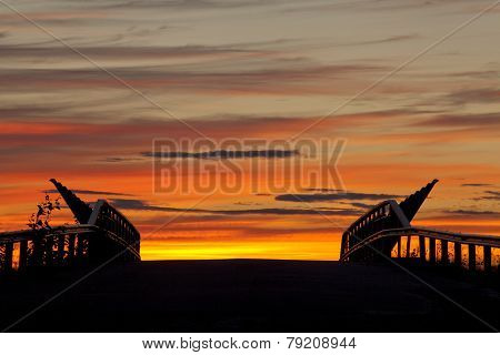 Part of a bridge in sunset.