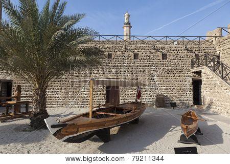Fishing boats in the courtyard of Al Fahidi Fort. Dubai, United Arab Emirates.