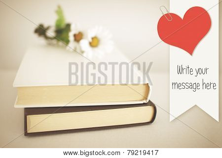 White book adorned with flowers and Bookmark