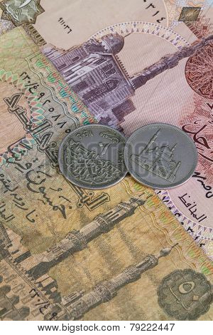 Different Egyptian Coins And Banknotes On The Desk