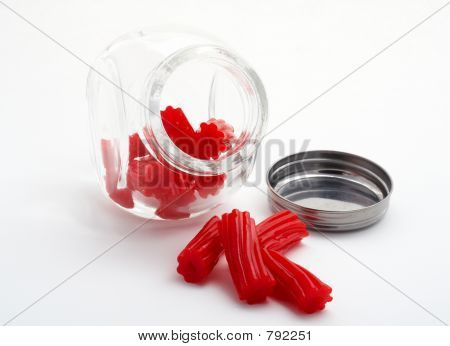 Pieces of red licorice on glass jar