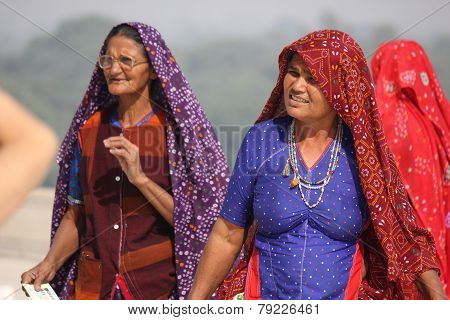 Two Indian Woman With Traditional Veil At Taj Mahal In Delhi