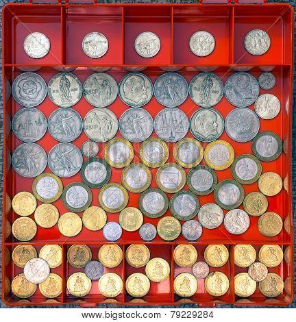Commemorative coins in a box-organizer.