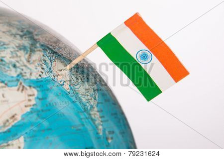 Indian flag pointing on New Delhi in  globe. Shallow depth of field,