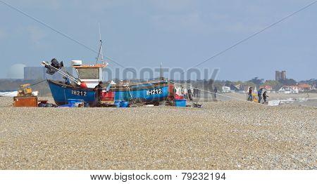 Fishermen mending nets on Aldeburgh Beach