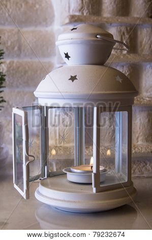 Flashlight for candles on the mantelpiece