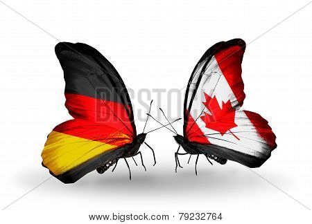 Two Butterflies With Flags On Wings As Symbol Of Relations Germany And Canada