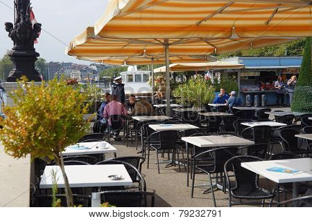 GENEVA - SEP 11: cafe near lake on September 11, 2014 in Geneva, Switzerland. Geneva is the second most populous city in Switzerland and is the most populous city of Romandy