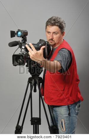 Cameraman in red vest,