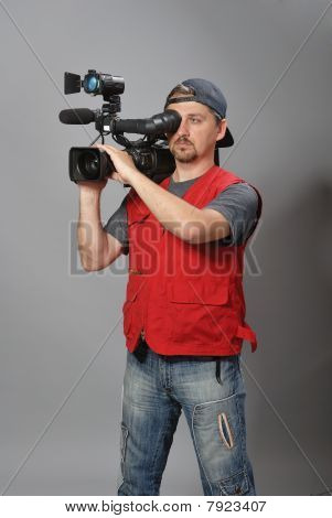 Cameraman in red vest